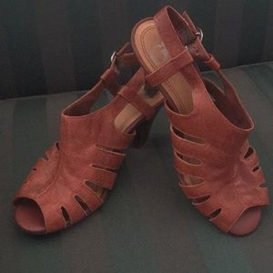 Strappy heels. The heel tips are a little worn.